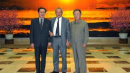 Naguib Sawiris stands between Kim Jong Il and Jang Song Thaek.