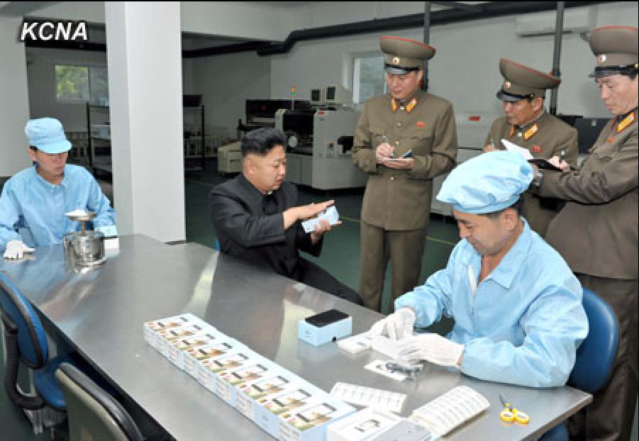 Kim Jong Un Visits Cell Phone Factory