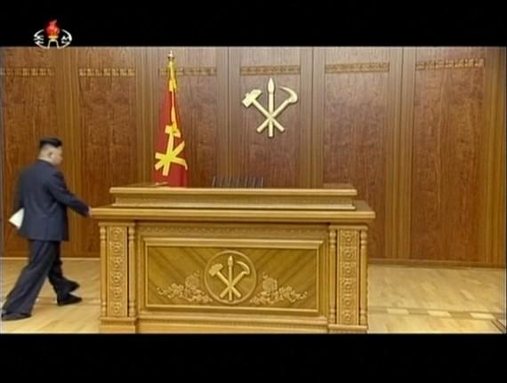 Kim Jong Un walks towards a dais to deliver his 2014 new year speech. KCTV screengrab.