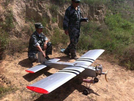 An unmanned aircraft produced by Taiyuan Navigation Friend Aviation Technology is seen with Chinese military members (Company photo)