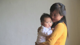 A new mother with her baby at the pediatric ward of City Hospital in Pyongsong City, South Pyongan Province, on May 20, 2014. (UN handout/NorthKoreaTech)