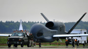An RQ-4 Global Hawk from Andersen Air Force Base, Guam is towed down the taxiway at Misawa Air Base, Japan, May 24, 2014. The RQ-4 Global Hawk is a high-altitude, long-endurance unmanned aircraft system with an integrated sensor suite that provides intelligence, surveillance and reconnaissance, or ISR, capability worldwide. (U.S. Air Force photo/Staff Sgt. Nathan Lipscomb)