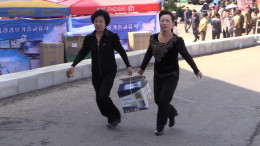 Women carry a Panasonic rice cooker at the Pyongyang Spring International Trade Fair 2014 (Photo: North Korea Tech/Aram Pan)