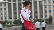 A woman speaks on a cellphone in Pyongyang on September 5, 2010 (Photo: Roman Harak / CC-by-sa-2.0)