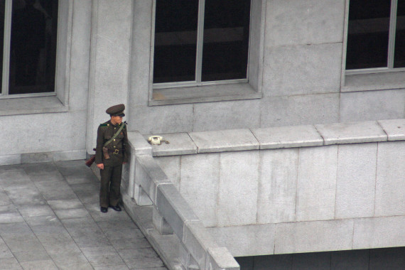 A guard stands next to a telephone in Pyongyang on September 10, 2010 (Photo: Roman Harak / CC-by-sa-2.0)