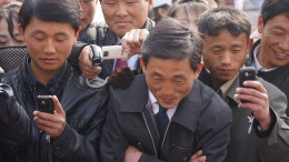 A group of North Koreans with cellphones take pictures in April 2012 (Photo: Joseph Ferris III/CC-by-2.0)