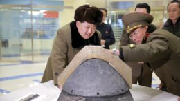 North Korean leader Kim Jong Un looks at a rocket warhead tip after a simulated test of atmospheric re-entry of a ballistic missile, at an unidentified location in this undated file photo released by North Korea's Korean Central News Agency (KCNA) in Pyongyang on March 15, 2016.     REUTERS/KCNA/Files