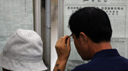 People read the Rodong Sinmun on the Pyongyang subway on Sept. 8, 2010. (Photo: Roman Harak)