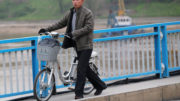 A man pushes an electric bicycle over the bridge in Pyongyang, North Korea May 6, 2016.  REUTERS/Damir Sagolj