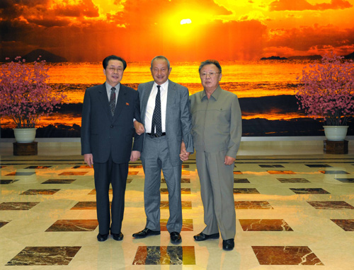 Naguib Sawiris stands between Kim Jong Il and Jang Song Thaek.