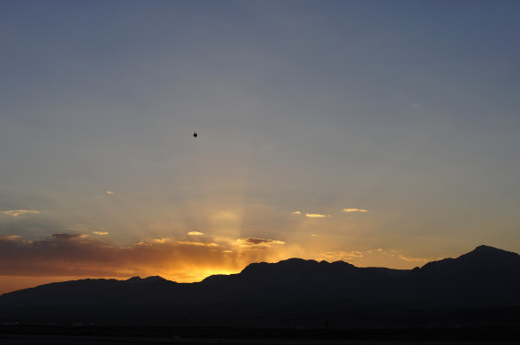 A tethered blimp gets an early peek at the rising sun over Camp Marmal in Northern Afghanistan on January 26, 2013. (File / U.S. Air Force / Tech. Sgt. Parker Gyokeres)