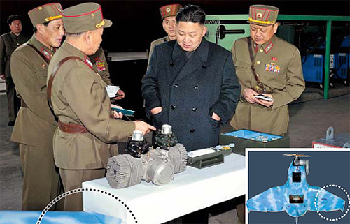 Kim Jong Un is shown looking at a small engine in this image released by the Korean Central News Agency on March 25, 2013.