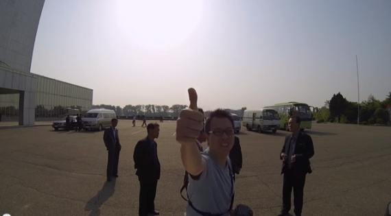Aran Pan gives a thumbs up at the beginning of his GoPro drive through Pyongyang video.