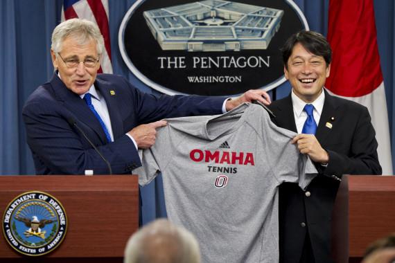 U.S. Defense Secretary Chuck Hagel, left, gives Japanese Defense Minister Itsunori Onodera a University of Nebraska tennis shirt at the Pentagon, July 11, 2014. (Photo: DoD/Casper Manlangit)