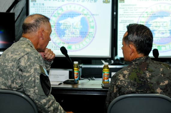 Lieutenant General Stephen Lanza, I Corps Commanding General, briefs Admiral Choi Yoon Hee, Chairman of Joint Chiefs of Staff for the Republic of Korea, about the operations with the Third ROK Army and I Corps in preparation for Ulchi Freedom Guardian exercise at Camp Yongin, South Korea, Aug. 20. (DOD Photo / Daniel Schroeder)