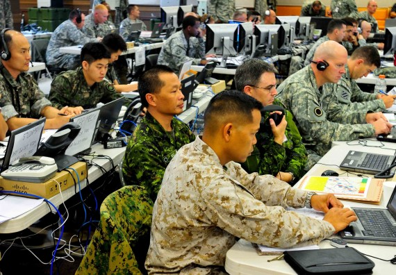 U.S. service members, 1st Canadian Division troops and soldiers from the Third Republic of Korea Army work side-by-side in the I Corps joint operations center in Camp Yongin, South Korea during a combined arms rehearsal meeting Aug. 21. (DOD Photo / Daniel Schroeder)