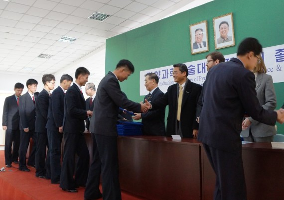 Students accept degrees during a graduation ceremony at the Pyongyang University of Science and Technology on November 19, 2014 (Photo: PUST)