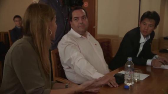Alejandro Cao de Benós, center, sits alongside Al Jazeera journalist Teresa Bo, left, in the TV station's Fault Lines documentary. (Photo: North Korea Tech)