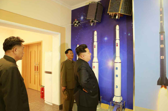 Kim Jong Un observes models of the Unha rocket series and the satellites they were launching into orbit in this image from the Rodong Sinmun on May 3, 2015.