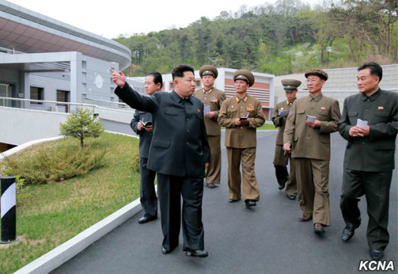 Kim Jong Un strolls through the General Satellite Control and Command Centre in this undated picture carried by KCNA on May 3, 2015.